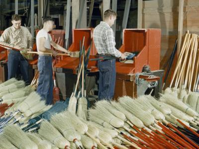 Men Work at Revolving Cylinders That Clean and Comb Broom Fibers by Willard Culver