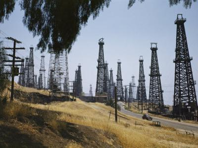 Oil Rigs Line the Road Near Long Beach by Willard Culver