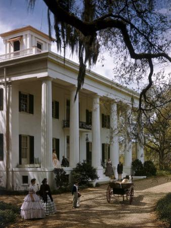People in Period Costumes Stand Outside Greek Revival Plantation Home by Willard Culver