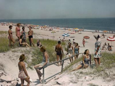 Sunbathers and Beach Umbrellas Dot the Shore Along the Atlantic by Willard Culver