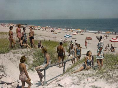 Sunbathers and Beach Umbrellas Dot the Shore Along the Atlantic