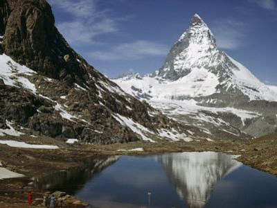 Tourists View the Matterhorn and its Reflection in Alpine Lake by Willard Culver