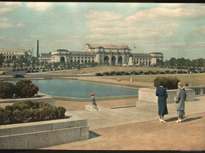 Two Women Look Across Captial Park and its Reflecting Pool Toward Union Station by Willard Culver