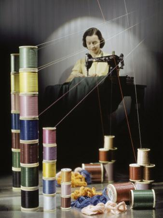 Woman Sews with Spools of Thread in Foreground by Willard Culver