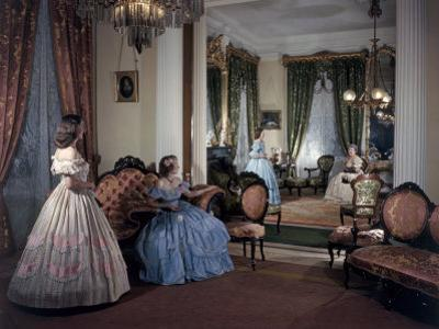 Women in Period Costumes Sit in an Antebellum Mansion's Drawing Room by Willard Culver