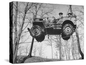 Group of Us Soldiers Pulling a Jeep over a Ravine Using Ropes while on Maneuvers by William C. Shrout