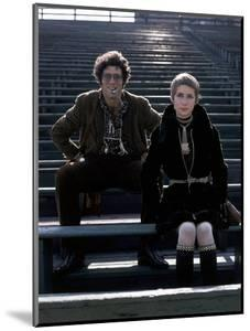 Glamour - December 1969 - Elliott Gould and Model in Stadium by William Connors