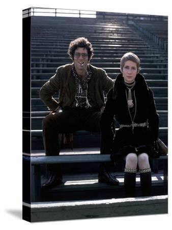 Glamour - December 1969 - Elliott Gould and Model in Stadium