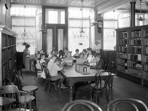 Children Reading in the Reading Room of an Unidentified Branch of the Queens Borough Public Library by William Davis Hassler