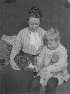 Harriet E. Hassler and William Gray Hassler, Seated with Tabby Cat (Reddy) and Teddy Bear, C.1911 by William Davis Hassler