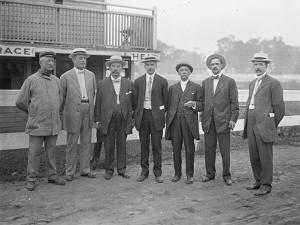 Seven Unidentified Men Pose Near a River or Lake, C.1910 by William Davis Hassler