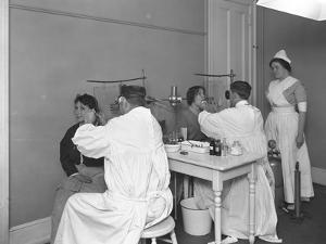 Two Patients Being Examined, Examining Room #1, Seton Hospital, Spuyten Duyvil, Bronx, Oct 30, 1914 by William Davis Hassler