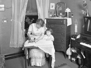 Unidentified Woman Demonstrating the Use of an Electric Iron, Watched by Little Girl, C.1913-14 by William Davis Hassler