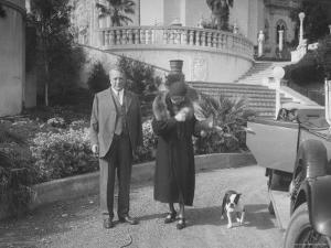 William Randolph Hearst and Mrs. Burton Holmes at San Simeon Estate with Boston Bull Terrier by William Davis