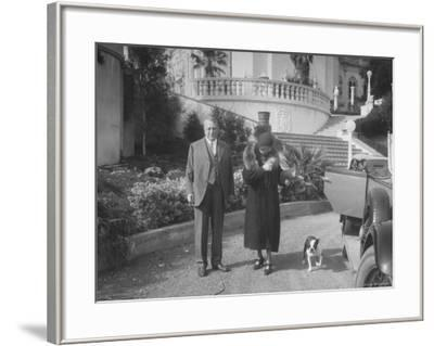 William Randolph Hearst and Mrs. Burton Holmes at San Simeon Estate with Boston Bull Terrier