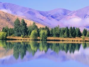 Lake Reflecting Trees Against Mountains by William Manning