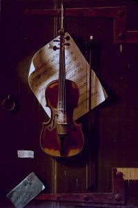 The Old Violin by William Michael Harnett
