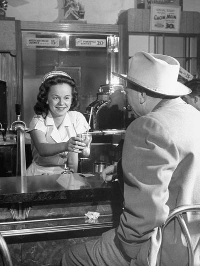 William O. Douglas's Daughter Serving Him a Soda at the Drugstore--Photographic Print