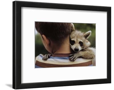 Boy Holding a Raccoon