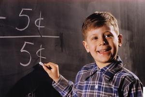 Boy Subtracting on a Blackboard by William P. Gottlieb