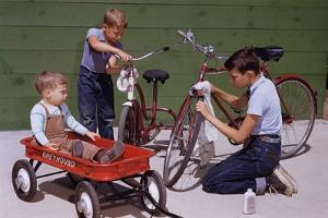 Boys Cleaning their Bikes by William P. Gottlieb