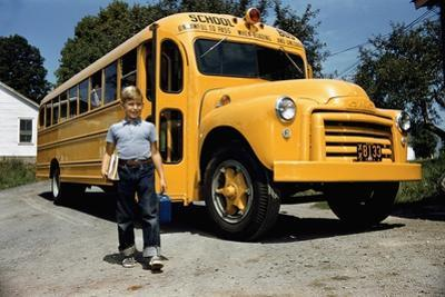 School Bus Dropping Off Child at Home by William P. Gottlieb