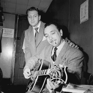 Django Reinhardt and David Rose at the Aquarium in New York City,1946 by William Paul Gottlieb