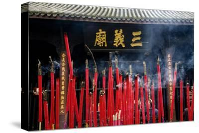 Burning Incense in the Temple of Three Kingdoms, Wuhou Memorial, Chengdu, Sichuan, China