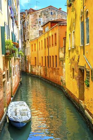 Colorful small canal bridge and reflection, Venice, Italy