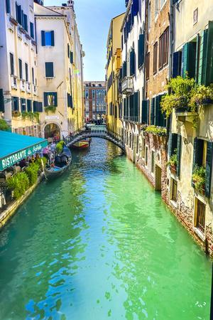 Gondola and tourist, Venice, Italy.