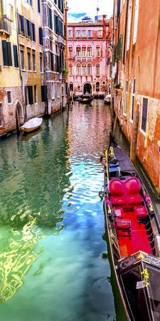 Small canal bridge, red fancy gondola, Venice, Italy