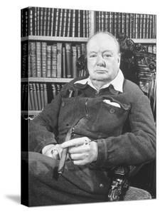 Winston Churchill Holding Cigar, Seated in Study at Chartwell Wearing Zippered Jumpsuit by William Sumits