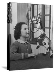 Young Child Starring at Marionette Muffin the Mule by William Sumits