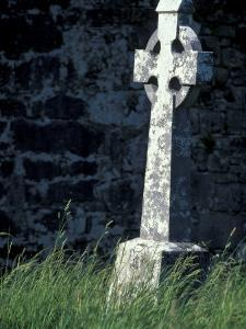 Celtic Cross at Dysart O'dea church, County Clare, Ireland by William Sutton
