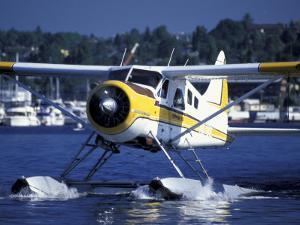 Float Plane Taxiing to Terminal on Lake Union, Washington, USA by William Sutton