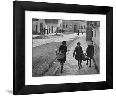 A View of Jewish Children Walking Through the Streets of their Ghetto