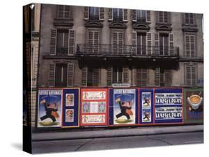 Advertising Posters Plastered on a Wall Along the Rue de Courcelles by William Vandivert