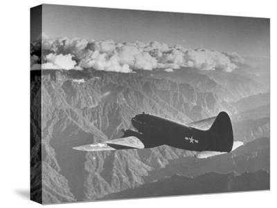 "American C-46 Transport Flying ""The Hump"" a Long, Difficult Flight over the Himalayas"