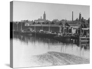 Barrels of Guiness's Stout Sitting in Front of the Brewery on the River Liffey, Dublin by William Vandivert