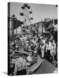 Crowds Walking Up and Down the Midway at a Carnival by William Vandivert