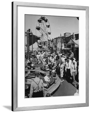 Crowds Walking Up and Down the Midway at a Carnival