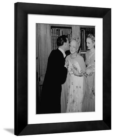 Famed Interior Decorator Lady Mendl Being Kissed by Oliver Messel at the British Embassy
