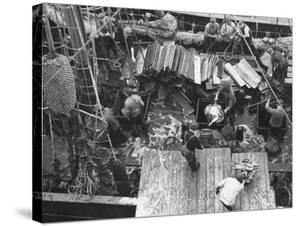 Men Unloading the Grimsby Trawler at Number Four Fish Dock by William Vandivert