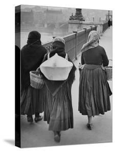 Peasant Women on a Bridge in Budapest by William Vandivert
