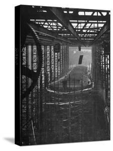Shipbuilding, 10,000 Ton Merchantman Frames on Overhead Trolley Crane Dropping Plate into Position by William Vandivert