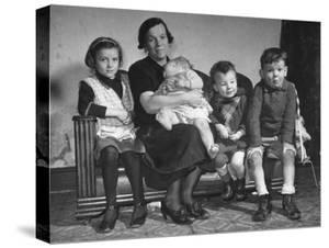 The Mcdougall Family Posing for a Portrait in their Home by William Vandivert