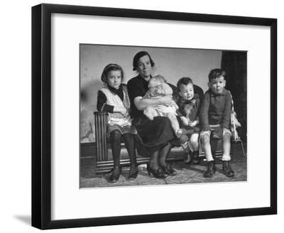 The Mcdougall Family Posing for a Portrait in their Home