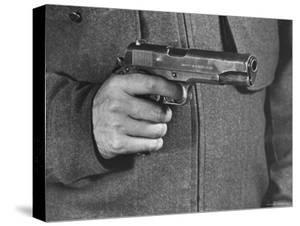 View of a Soldier Holding a US Army Colt Automatic .45 Caliber Pistol by William Vandivert