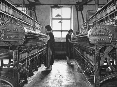 Young Girls Working in the Hot, Damp and Dirty York Street Flax Spinning Co by William Vandivert