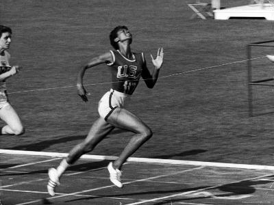 Wilma Rudolph, Across the Finish Line to Win One of Her 3 Gold Medals at the 1960 Summer Olympics-Mark Kauffman-Premium Photographic Print
